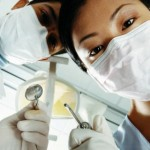 Below View of Male and Female Dentists Wearing Face Masks